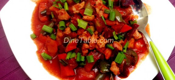 Chicken with vegetable stir fry in tomato, chilli and dark soya sauce